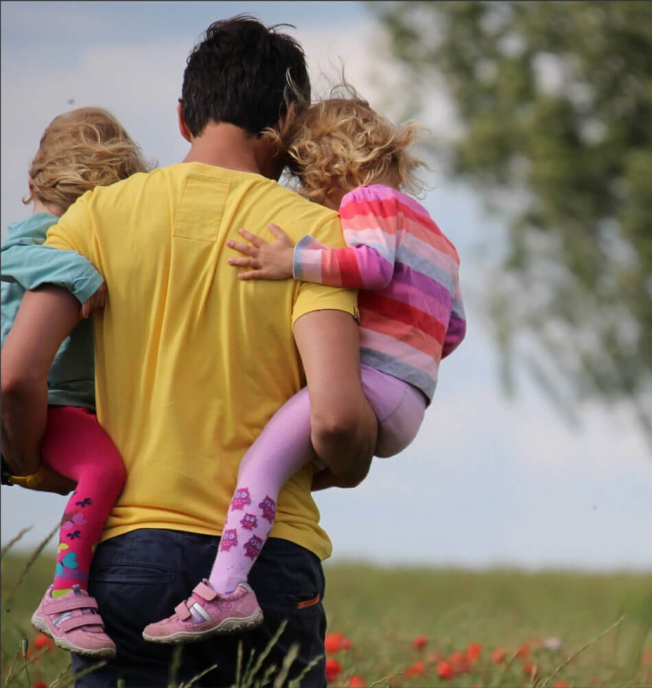 dad-carrying-two-kids